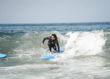 Surfer in the surf course in Lisbon