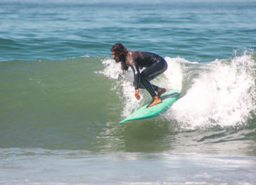 Guest surfs green right wave